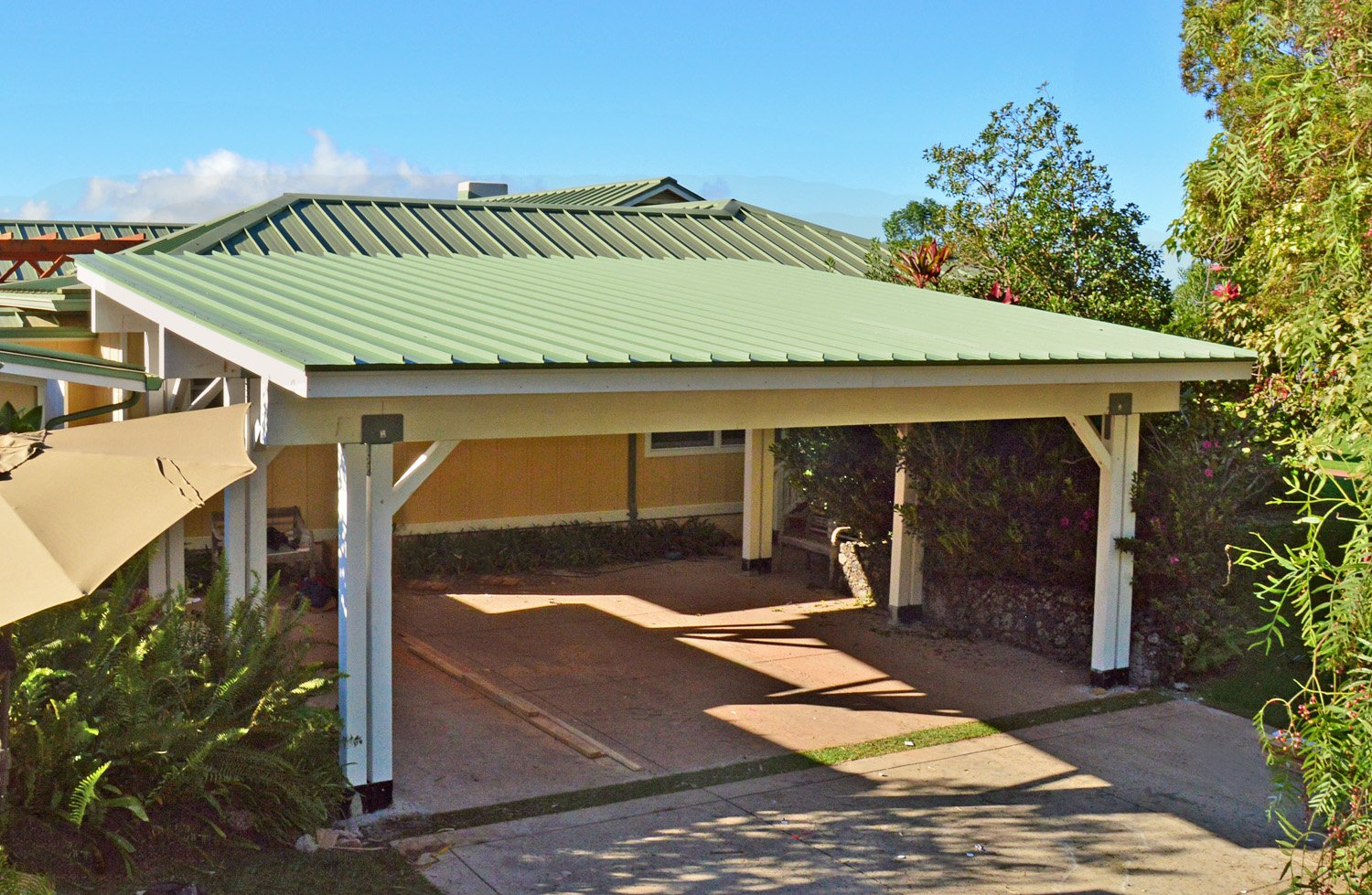 The roofing of this Carport Pavilion was selected to match the existing roofing of the home.