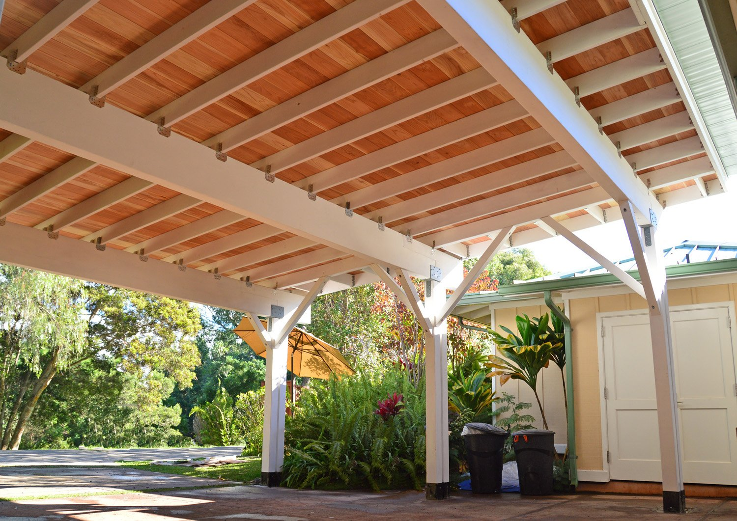 Carport Pavilion in California Redwood. Unfinished ceiling by custom request.