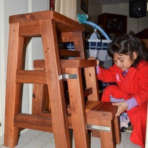 "OPENED: Folding 3-Step Stool (Options: 18""W X 30""H, Redwood, No Engraving, Transparent Premium Sealant). Photo of Ms. Stephanie Alvarez courtesy of the Alvarez family of Ensenada, Mexico."