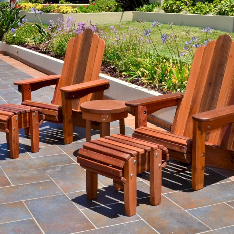 Adirondack Flat Ottoman (Options: Old-Growth Redwood, Transparent Premium Sealant). Photo also shows Adirondack Folding Chairs.