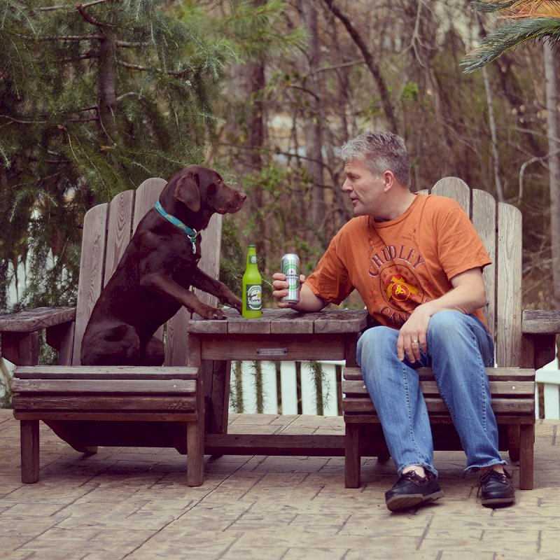 Adirondack Vignette Settee. Photo Courtesy of Magnus Rundqwist & Scout (the Chocolate Lab). Photo shows finish after 5 years out in the weather...
