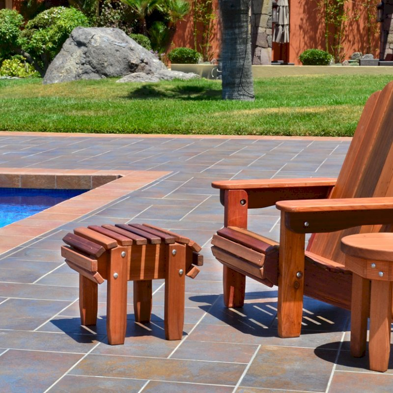 Adirondack Folding Chair (Options: Old-Growth Redwood, No Cushions, Add Flat Ottoman, Transparent Premium Sealant). Photo also shows Round Side Table.
