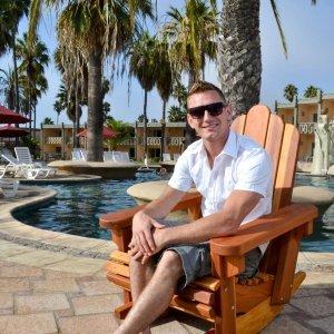 Adirondack Rocking Chair (Options: Standard Width, Redwood, No Cushion, No Ottoman, Transparent Premium Sealant). Photo Courtesy of The Estero Beach Resort, Ensenada, Mexico.