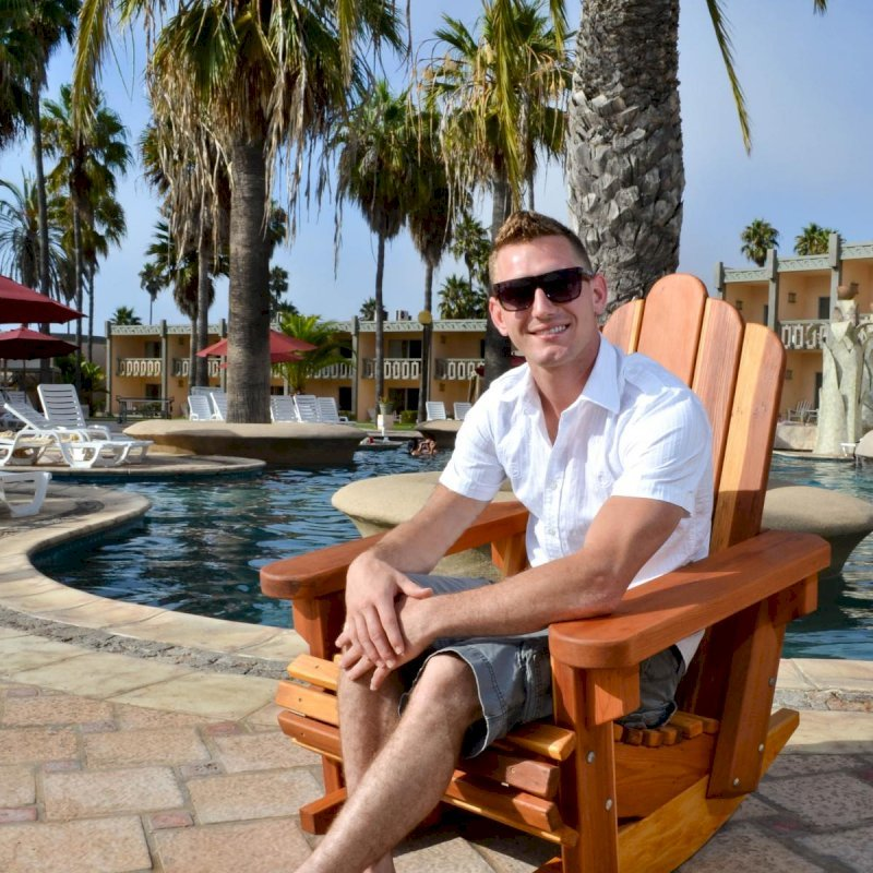 Adirondack Rocking Chair (Options: Standard Width, California Redwood, No Cushion, No Ottoman, Transparent Premium Sealant). Photo Courtesy of The Estero Beach Resort, Ensenada, Mexico.