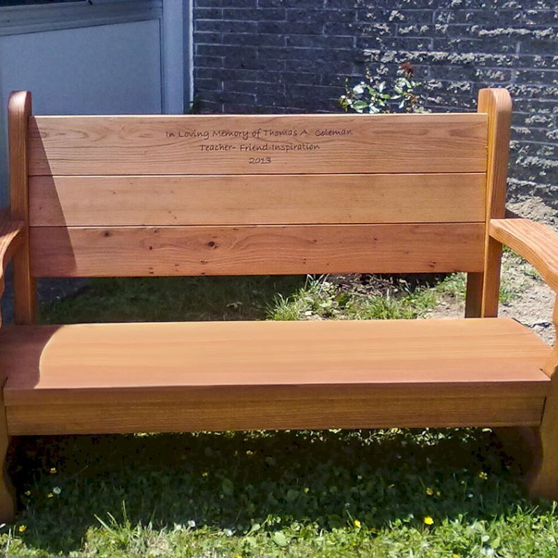 Angel's Bench (Options: 5 ft, Mature Redwood, No Cushion, Custom Engraving, Transparent Premium Sealant). Photo Courtesy of Herricks Middle School and Nora Koe.