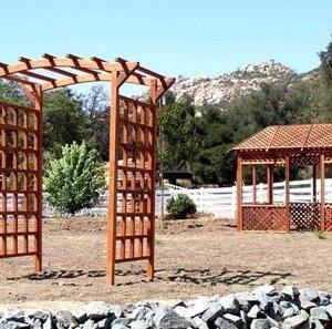"Arched Garden Arbor (Options: 96"" W x 48"" D, Mature Redwood, No Anchor Kit, Transparent Premium Sealant). Lattice Pavilion Gazebo shown in background. Photo Courtesy of Mr. Greg Alford of Jamul, CA."