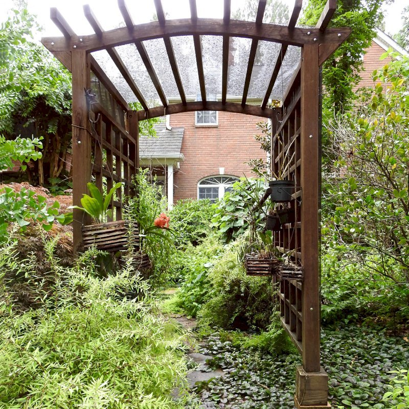 """Arched Garden Arbor (Options: 48"""" W x 60"""" D, Mature Redwood, Anchor Kit for Concrete, Transparent Premium Sealant). Photo Courtesy of S. Fly of Millsboro, Delaware."""