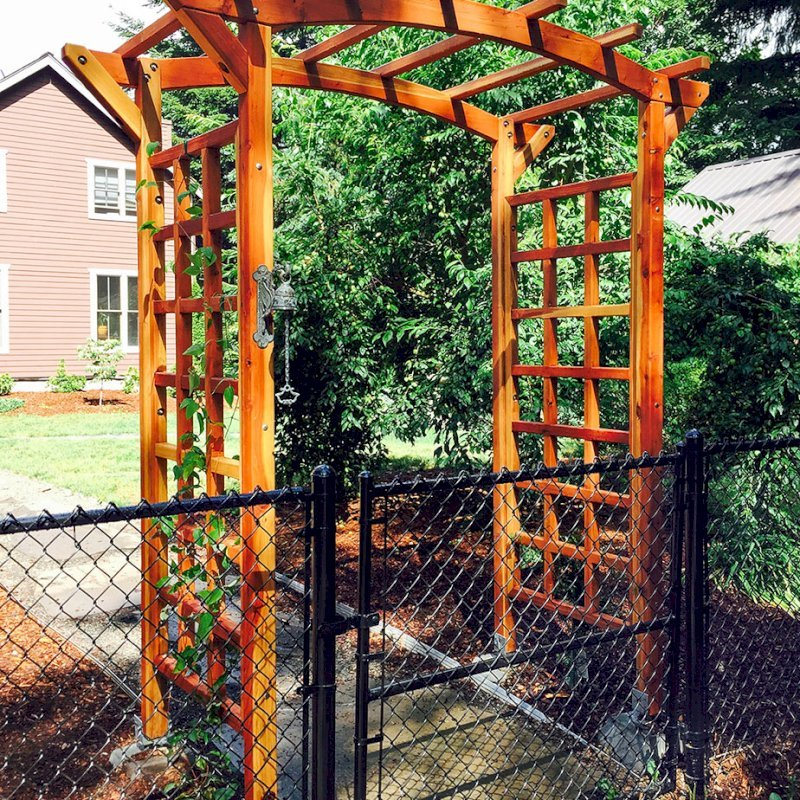 """Arched Garden Arbor (Options: 60"""" W x 36"""" D, California Redwood, No Anchor Kit, Transparent Premium Sealant). Photo Courtesy of Evelyn and Dan Martin of Poulsbo, Washington."""