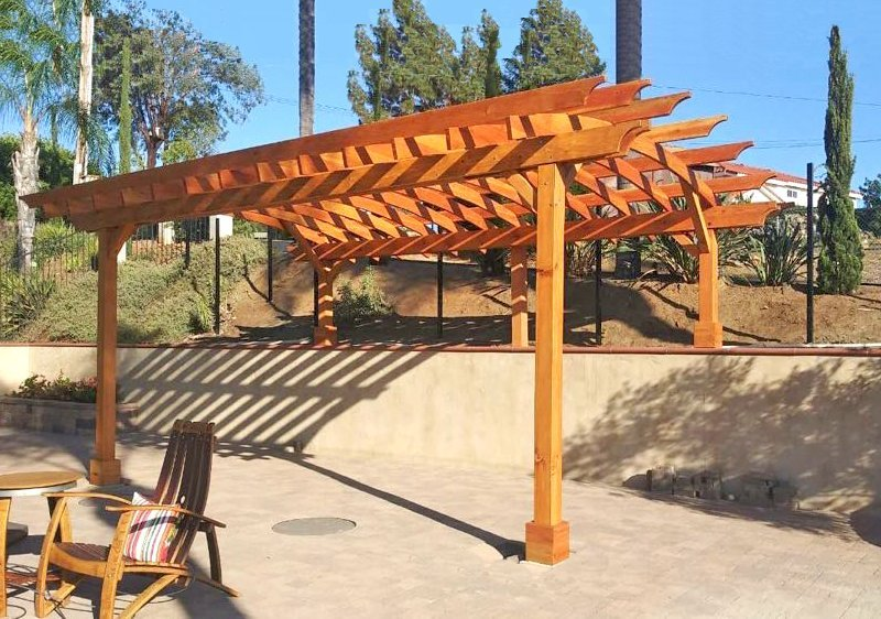 Arched Open Sky Pergola (Options: 22' L x 15' Arc W, Douglas-fir, No Electrical Wiring Trims, 4 Post Anchor Kit for Concrete, 2' Overhangs by Custom Request, No Ceiling Fan Base, No Privacy Panels, No Curtain Rods, 2 Posts are 10' H and the Posts on the Pony Wall are 5' H, Transparent Premium Sealant). Photo Courtesy of J. Marca of Escondido, California.