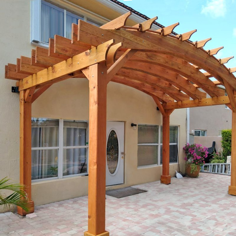 Custom Arched Open Sky Pergola (Options: Douglas-fir, 10' H Posts, 4-Post Anchor Kit for Gale-Wind, Transparent Premium Sealant). Shows custom wall anchor customization to attach to home (can be added upon request).
