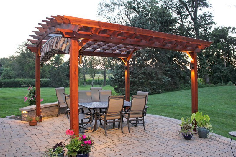 "Arched Open Sky Pergola (Options: 14' L x 14' Arc W, California Redwood, Unattached, Electrical Wiring Trim for 2 Posts, Arched Roof without Lattice Panels, 4 Post Anchor Kit for Concrete, No Ceiling Fan Base, No Privacy Panels, No Curtain Rods, 9' Post Height, Transparent Premium Sealant). 18"" Overhang of Arches. Ends of arches with Same Roosevelt End Detail Work as Have the Supports and Slats. Pergola Installed in 2014. Photo Courtesy of J. Martin of Morgantown, Pennsylvania."