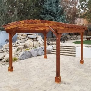 Arched Open Sky Pergola (Options: 15' L x 14' Arc W, Redwood, 1 Electrical Wiring Trim, 4 Post Anchor Kit for Hurricane, 1 Ceiling Fan Base, No Privacy Panels, No Curtain Rods, 9' Post Height, Transparent Premium Sealant). Photo Courtesy of D. Cozzi of Reno, Nevada.