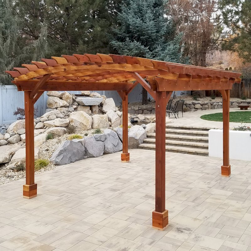 Arched Open Sky Pergola (Options: 15' L x 14' Arc W, California Redwood, 1 Electrical Wiring Trim, 4 Post Anchor Kit for Hurricane, 1 Ceiling Fan Base, No Privacy Panels, No Curtain Rods, 9' Post Height, Transparent Premium Sealant). Photo Courtesy of D. Cozzi of Reno, Nevada.