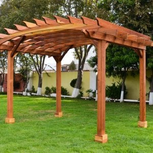 Arched Open Sky Pergolas (Options: 10' L x 14' Arc W, Redwood, Unattached, 2 Posts - Electrical Wiring Cutout & Trim [see left most post for detail], Arched Roof without Lattice Panels, 4 Post Anchor Kit for Stone, No Ceiling Fan Base, No Privacy Panels, No Curtain Rods, 9' Post Height, Transparen​t Premium Sealant).