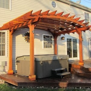 Arched Open Sky Pergolas (Options: 10' L  x 14' Arc W, Redwood, Unattached, No Electrical Wiring Trim, Arched Roof without Lattice Panels, 4 Post Anchor Kit for Wood, No Ceiling Fan Base, No Privacy Panels, No Curtain Rods, 9'  Post Height [custom length for 2 posts], Transparent Premium Sealant). Photo Courtesy of Doug K. of Erie, Michigan.