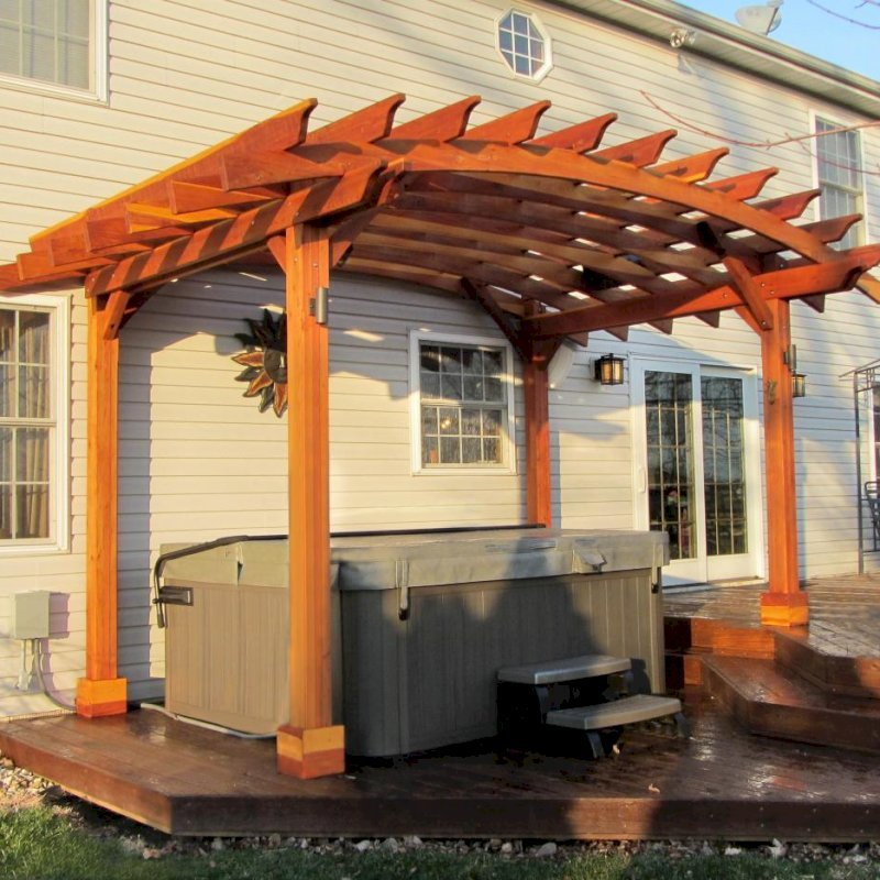 Arched Open Sky Pergolas (Options: 10' L  x 14' Arc W, California Redwood, Unattached, No Electrical Wiring Trim, Arched Roof without Lattice Panels, 4 Post Anchor Kit for Wood, No Ceiling Fan Base, No Privacy Panels, No Curtain Rods, 9'  Post Height [custom length for 2 posts], Transparent Premium Sealant). Photo Courtesy of Doug K. of Erie, Michigan.