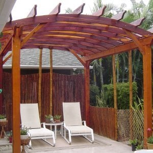 Arched Open Sky Pergolas (Options: 14' L x 12' Arc W, Redwood, Unattached, No Electrical Wiring Trim, Arched Roof without Lattice Panels, 4 Post Anchor Kit for Stone, No Ceiling Fan Base, No Privacy Panels, No Curtain Rods, 9' Post Height, Transparent Premium Sealant). Photo courtesy of Jeff Bigler of Wailuku, HI.