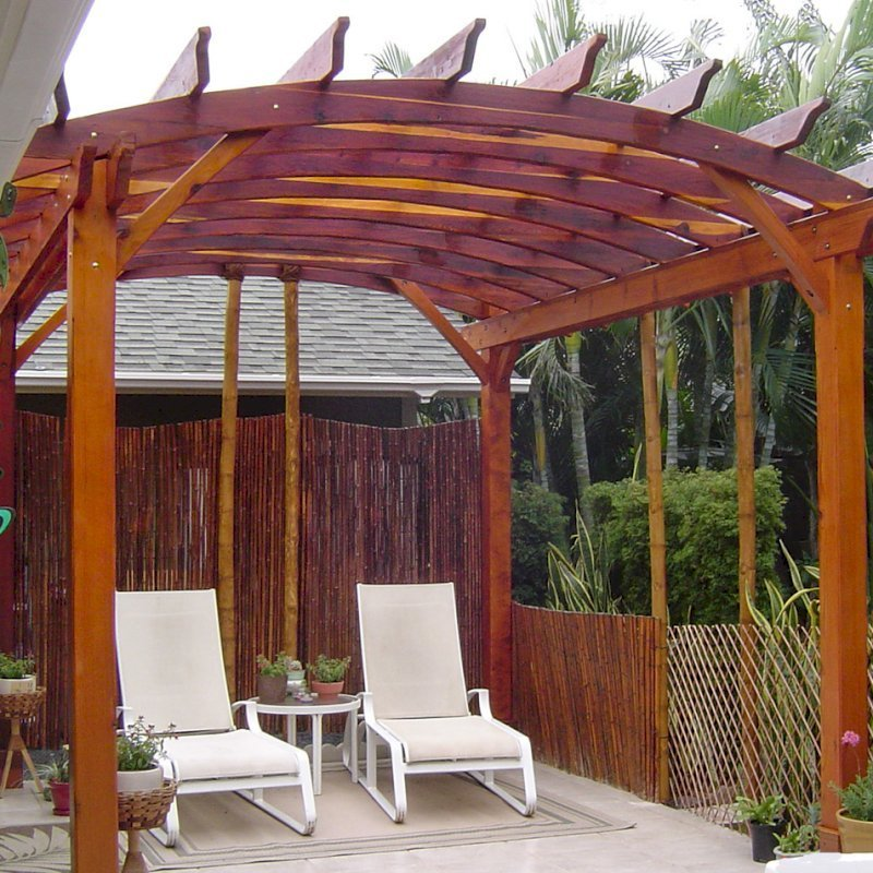 Arched Open Sky Pergolas (Options: 14' L x 12' Arc W, California Redwood, Unattached, No Electrical Wiring Trim, Arched Roof without Lattice Panels, 4 Post Anchor Kit for Stone, No Ceiling Fan Base, No Privacy Panels, No Curtain Rods, 9' Post Height, Transparent Premium Sealant). Photo courtesy of Jeff Bigler of Wailuku, HI.