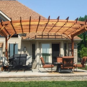 Arched Open Sky Pergolas (Options: 20' L x 18' Arc W, Redwood, Unattached, No Electrical Wiring Trim, Arched Roof without Lattice Panels, 4 Post Anchor Kit for Stone, No Ceiling Fan Base, No Privacy Panels, No Curtain Rods, 9.5' Post Height, Transparent Premium Sealant). Photo Courtesy of David Gordon of Newport, Michigan.