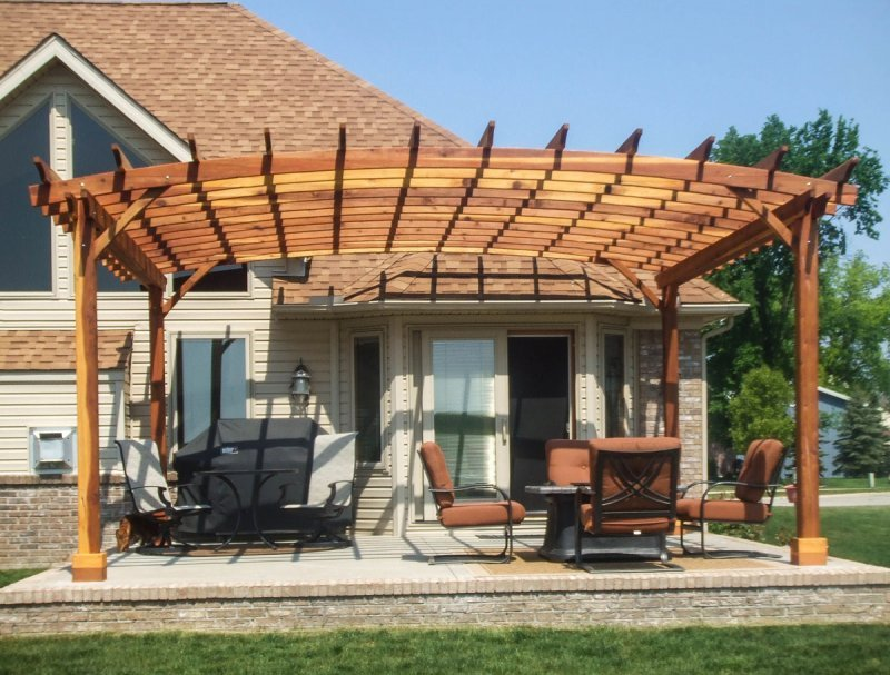 Arched Open Sky Pergolas (Options: 20' L x 18' Arc W, California Redwood, Unattached, No Electrical Wiring Trim, Arched Roof without Lattice Panels, 4 Post Anchor Kit for Stone, No Ceiling Fan Base, No Privacy Panels, No Curtain Rods, 9.5' Post Height, Transparent Premium Sealant). Photo Courtesy of David Gordon of Newport, Michigan.