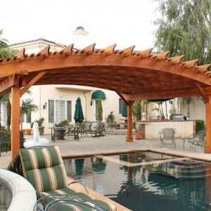 Arched Open Sky Pergolas (Options: 26' L x 24' Arc W, Mature Redwood, Unattached, Open Roof with Extra Slats by Custom Request, Transparent Premium Sealant). Photo Courtesy of Ms. Diane Williams of Encinitas, CA. Photo shows extra large timber custom design with 8x8 posts and 2x10 arches, 26 ft long.