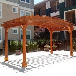 Arched Open Sky Pergola (Options: 10' L x 20' Arc W, Redwood, No Electrical Wiring Trim, Horizontal Decorative Trims on Posts, 4 Post Anchor Kit for Concrete, No Ceiling Fan Base, No Privacy Panels, No Curtain Rods, 9' Post Height, Transparent Premium Sealant). Photo Courtesy of M. Castaneda of Pleasanton, CA.