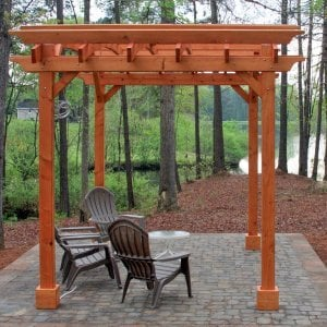 Arched Open Sky Pergolas (Options: 10' L x 14' Arc W, Mature Redwood, Unattached, No Electrical Wiring Trim, Arched Roof without Lattice Panels, 4 Post Anchor Kit for Stone, With Ceiling Fan Base, No Privacy Panels, No Curtain Rods, 9' Post Height, Transparent Premium Sealant). Photo Courtesy of Randall & Florence W. of Willow Spring, North Carolina.