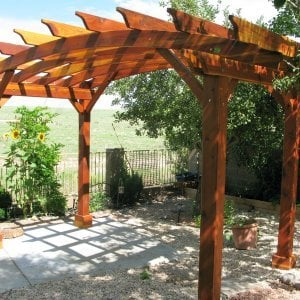 Arched Open Sky Pergolas (Custom Options: 8' L x 14' Arc W, Redwood, Unattached, No Electrical Wiring Trim, Arched Roof without Lattice Panels, 4 Post Anchor kit for Stone, No Ceiling Fan Base, No Privacy Panels, No Curtain Rods, 10' Post Height, Transparent Premium Sealant). Photo Courtesy of Pat P. of Prescott Valley, Arizona.