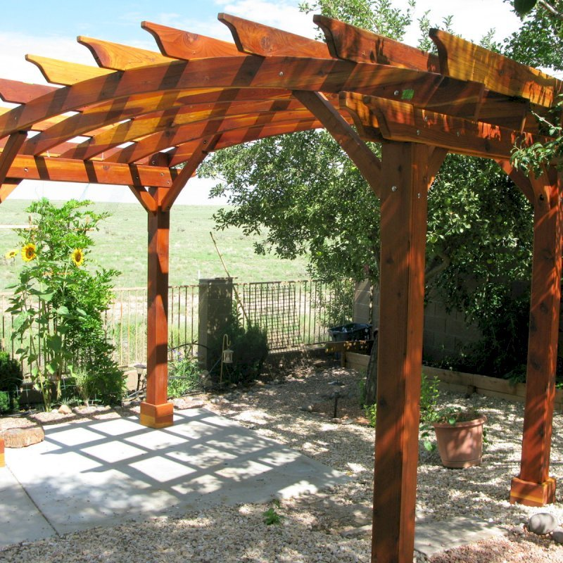 Arched Open Sky Pergolas (Custom Options: 8' L x 14' Arc W, California Redwood, Unattached, No Electrical Wiring Trim, Arched Roof without Lattice Panels, 4 Post Anchor kit for Stone, No Ceiling Fan Base, No Privacy Panels, No Curtain Rods, 10' Post Height, Transparent Premium Sealant). Photo Courtesy of Pat P. of Prescott Valley, Arizona.