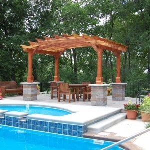 Arched Open Sky Pergolas (Options: 10' L x 14' Arc W, Redwood, Unattached, No Electrical Wiring Trim, Arched Roof Without Lattice Panels, 4 Post Anchor Kit for Stone, No Ceiling Fan Base, No Privacy Panels, No Curtain Rods, Custom Post Height, Transparent Premium Sealant). Photo Courtesy of Glen Vick of Lafayette, IN. Table set under Pergola not built by Forever Redwood.