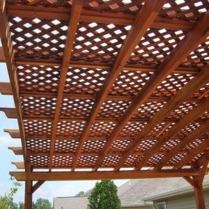 Arched Pergola Kits (Options: 14' L  x 20' Arc W, Redwood, Unattached, No Electrical Wiring Trim, Arched Roof with Lattice Panels, 4 Post Anchor Kit for Stone, No Ceiling Fan Base, No Privacy Panels, No Curtain Rods, 9' Post Height, Transparent Premium Sealant). Photo Courtesy of Mr. Jeff R. of Beaver Creek, Ohio.