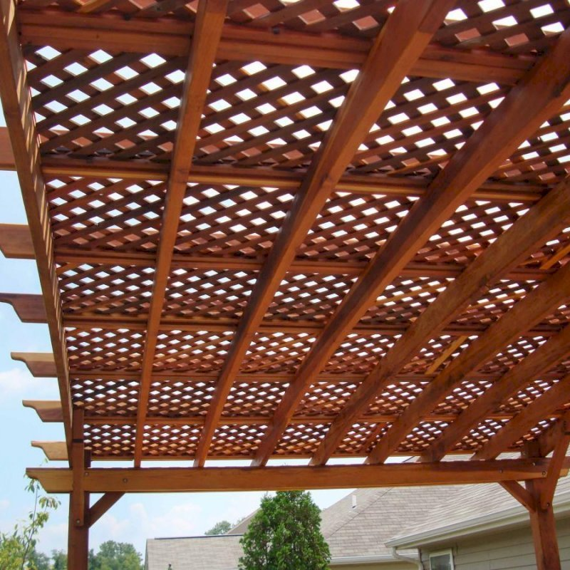Arched Pergola Kits (Options: 14' L  x 20' Arc W, California Redwood, Unattached, No Electrical Wiring Trim, Arched Roof with Lattice Panels, 4 Post Anchor Kit for Stone, No Ceiling Fan Base, No Privacy Panels, No Curtain Rods, 9' Post Height, Transparent Premium Sealant). Photo Courtesy of Mr. Jeff R. of Beaver Creek, Ohio.