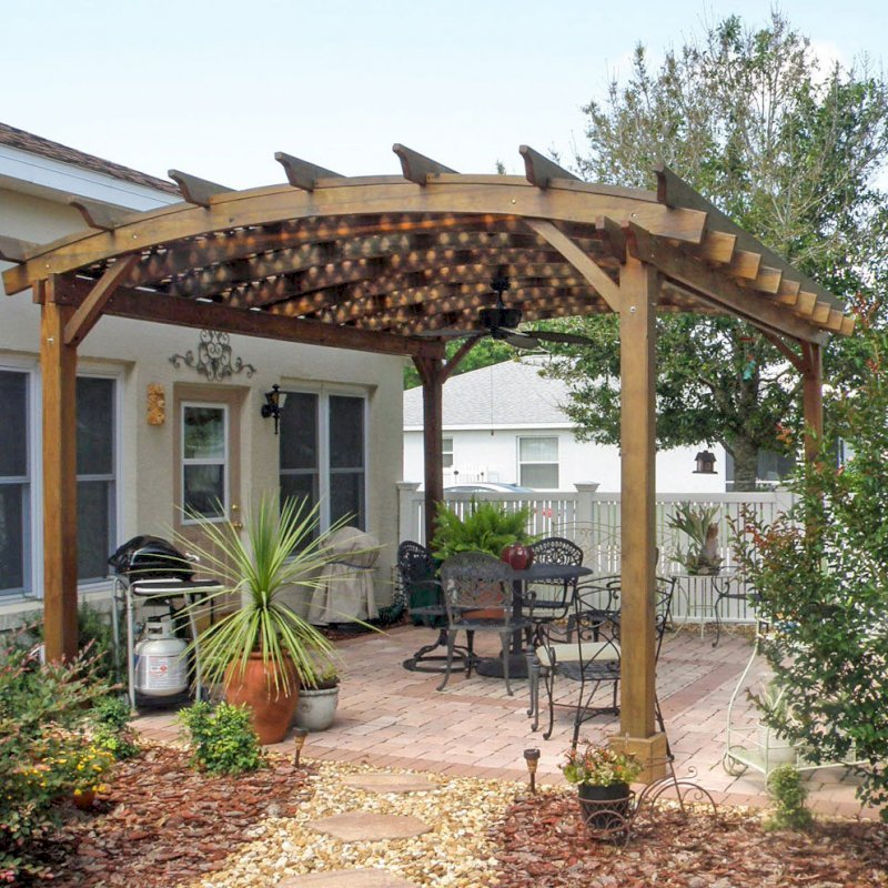 Arched Pergola Kits (Options: 18' L x 15' Arc W, California Redwood,Unattached, No Electrical Wiring Trim, Arched Roof with Lattice Panels, 4 Post Anchor Kit for Stone, Ceiling Fan Base, No Privacy Panels, No Curtain Rods, 9' Post Height, Transparent Premium Sealant). Here is how the same pergola looks after 3 years out in the Florida weather. Photo Courtesy of Bob Lilys of Central Florida.