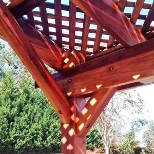 Arched Pergola Kit (Options: 16' L x 18' Arc W, Redwood, Electrical Wiring Trim Kit for 1 Post, 4 Post Anchor Kit for Concrete, No Ceiling Fan Base, No Privacy Panels, No Curtain Rods, 9' Post Height, Transparent Premium Sealant). Photo Courtesy of C. Klerk of Douglasville, Georgia.
