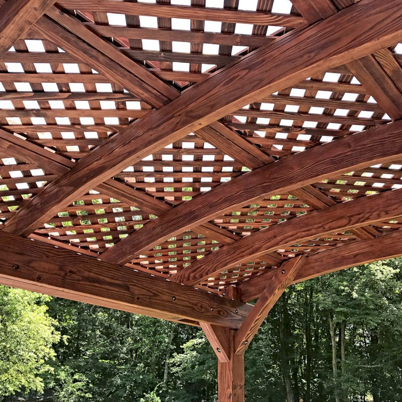 Arched Pergola Kit (Options: 14' L x 10' Arc W, Douglas-fir, No Electrical Wiring Trim Kit, 4 Post Anchor Kit for Concrete, No Ceiling Fan Base, No Privacy Panels, No Curtain Rods, 9' Post Height, Cherry Stain Premium Sealant). Photo Courtesy of D. McAlpine of Holliston, Massachusetts.