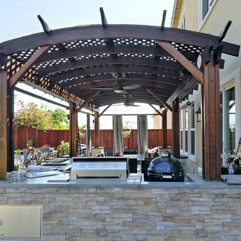 Arched Pergola Kit (Options: 26' L x 12' Arc W, California Redwood, 2 Electrical Wiring Trims, Vertical Post Decorative Trims, 2 Fan Bases, 2 Curtain Rods, No Privacy Panels, Coffee-Stain Premium Sealant). Photo Courtesy of D. Jackson of San Jose, California.