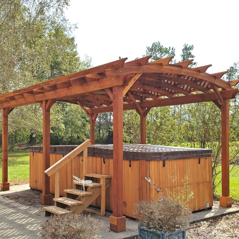 Arched Pergola Kit (Options: 22' L x 14' Arc W, California Redwood, Electrical Wiring Trim Kit for 2 Posts, 6 Post Anchor Kit for Concrete, 1 Ceiling Fan Base, No Privacy Panels, No Curtain Rods, 10' Post Height, Transparent Premium Sealant). Photo Courtesy of D. Lewis of Whiteville, North Carolina.