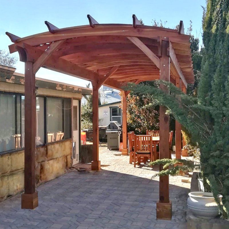 Arched Pergola Kit (Options: 30' L x 10' Arc W, California Redwood, 2 Electrical Wiring Trim Kits, 6 Post Anchor Kit for Concrete, No Ceiling Fan Bases, No Privacy Panels, No Curtain Rods, 9' Post Height, Transparent Premium Sealant). Photo Courtesy of J. Wangemann of Ridgecrest, CA.