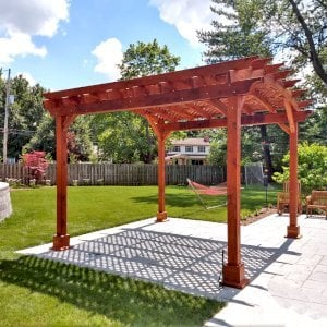 Arched Pergola Kit (Options: 14' L x 14' Arc W, Redwood, Electrical Wiring Trim Kit for 1 Post, 4 Post Anchor Kit for Concrete, 1 Ceiling Fan Base, No Privacy Panels, No Curtain Rods, 9.5' Post Height, Transparent Premium Sealant). Photo Courtesy of K. Murray of Grand Rapids, Michigan.