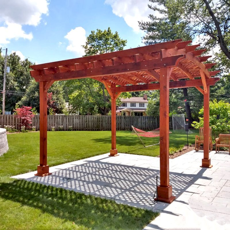 Arched Pergola Kit (Options: 14' L x 14' Arc W, California Redwood, Electrical Wiring Trim Kit for 1 Post, 4 Post Anchor Kit for Concrete, 1 Ceiling Fan Base, No Privacy Panels, No Curtain Rods, 9.5' Post Height, Transparent Premium Sealant). Photo Courtesy of K. Murray of Grand Rapids, Michigan.