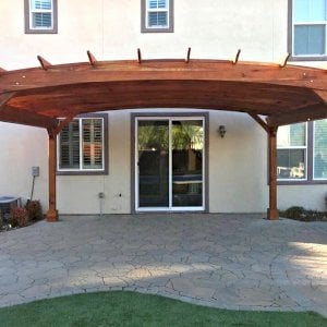 Arched Pergola Kit (Options: 15' L x 20' Arc W, Redwood, Electrical Wiring Trim Kit for 1 Post, 4 Post Anchor Kit for Concrete, No Ceiling Fan Base, No Privacy Panels, No Curtain Rods, 9' Post Height, Transparent Premium Sealant). Photo Courtesy of Myron Lee of Danville, CA.