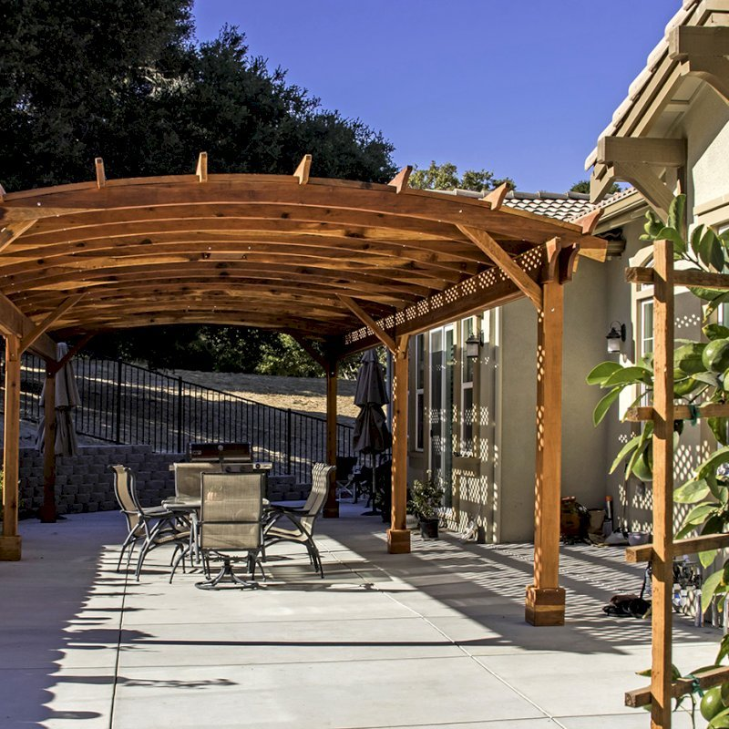 Arched Pergola Kit (Options: 39' L x 16' Arc W, California Redwood, Electrical Wiring Trim Kit for 2 Posts, 6 Post Anchor Kit for Concrete, 2 Ceiling Fan Bases, No Privacy Panels, No Curtain Rods, 9.5' Post Height, Transparent Premium Sealant). Photo Courtesy of S. Brunshwiler of Gilroy, CA,