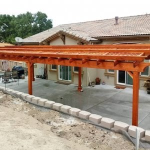 Arched Pergola Kit (Options: 39' L x 16' Arc W, Redwood, Electrical Wiring Trim Kit for 2 Posts, 6 Post Anchor Kit for Concrete, 2 Ceiling Fan Bases, No Privacy Panels, No Curtain Rods, 9.5' Post Height, Transparent Premium Sealant). Photo Courtesy of S. Brunshwiler of Gilroy, CA,
