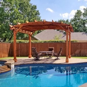 Arched Pergola Kit (Options: 12' L x 16' Arc W, Redwood, Electrical Wiring Trim Kit for 1 Post, 4 Post Anchor Kit for Concrete, 1 Ceiling Fan Base, No Privacy Panels, No Curtain Rods, 9' Post Height, Transparent Premium Sealant). Photo Courtesy of Trudy & Dog Heatherly of Coppell, Texas.