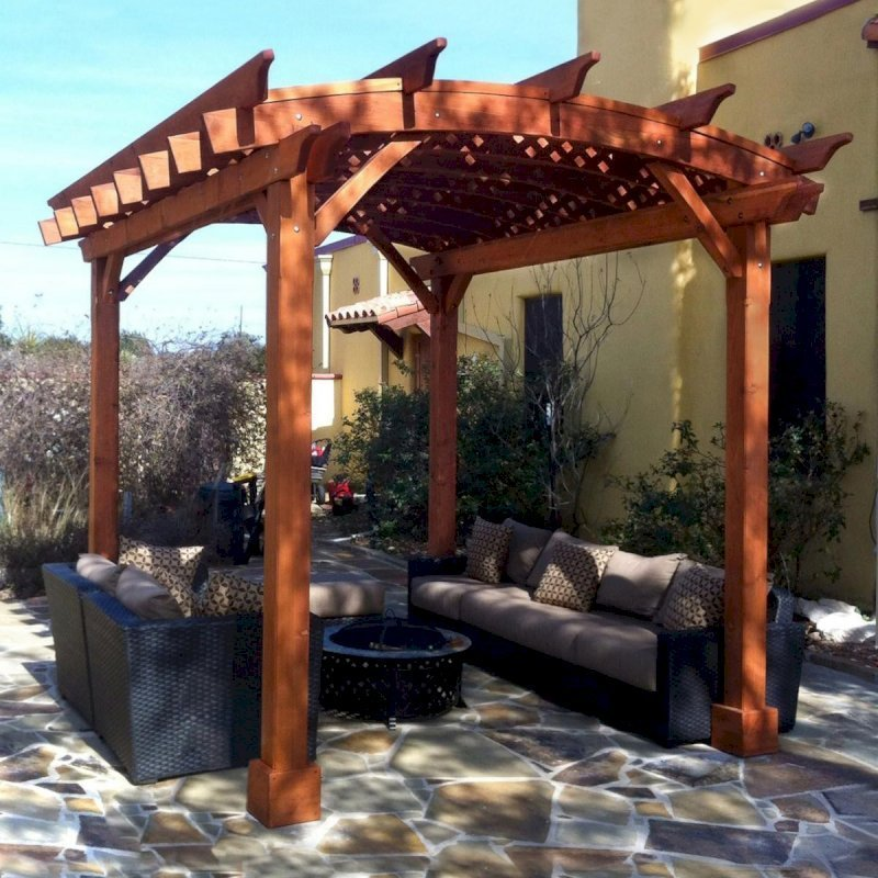 Arched Pergola Kits (Options: 12' L x 10' Arc W, California Redwood, Unattached, No Electrical Wiring Trim, Arched Roof with Lattice Panels, 4 Post Anchor Kit for Stone, No Ceiling Fan Base, No Privacy Panels, No Curtain Rods, 9' Post Height, Transparent Premium Sealant). Photo courtesy of Mr. Buzz Park of Spring Branch, Texas.