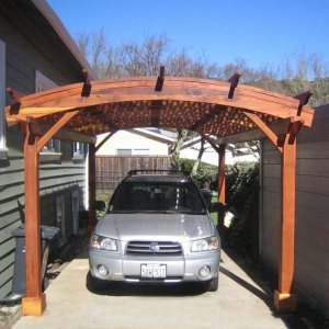 PERGOLA/CARPORT: Arched Pergola Kits (Options: 20' L x 12'  Arc W, Redwood, Unattached, No Electrical Wiring Trim, Arched Roof with Lattice Panels, 4 Post Anchor Kit for Stone, No Ceiling Fan Base, No Privacy Panels, No Curtain Rods, 9' Post Height, Transparent Premium Sealant). Photos Courtesy of Mr. Mark Hillard, Fairfax, CA.