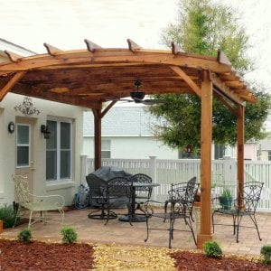 Arched Pergola Kits (Options: 18' L x 15' Arc W, Redwood, Unattached, No Electrical Wiring Trim, Arched Roof with Lattice Panels, 4 Post Anchor Kit for Stone, Ceiling Fan Base, No Privacy Panels, No Curtain Rods, 9'  Post Height, Transparent Premium Sealant). Photo Courtesy of Bob Lilys of Central Florida.