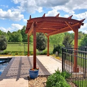 Arched Pergola Kit (Options: 24' L x 10' Arc W, Redwood, Electrical Wiring Trim Kit for 1 Post, 4 Post Anchor Kit for Concrete, 1 Ceiling Fan Base, No Privacy Panels, No Curtain Rods, 9' Post Height, Transparent Premium Sealant). Photo Courtesy of J. Goldberg of Earlysville, Virginia.