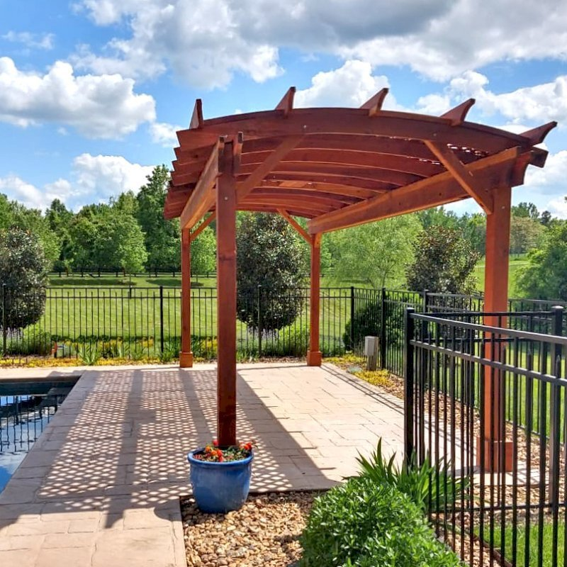 Arched Pergola Kit (Options: 24' L x 10' Arc W, California Redwood, Electrical Wiring Trim Kit for 1 Post, 4 Post Anchor Kit for Concrete, 1 Ceiling Fan Base, No Privacy Panels, No Curtain Rods, 9' Post Height, Transparent Premium Sealant). Photo Courtesy of J. Goldberg of Earlysville, Virginia.