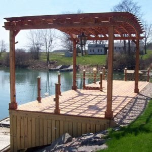 Arched Pergola Kits (Options: 14' L x 22' Arc W, Redwood, Unattached, No Electrical Wiring Trim, Arched Roof with Lattice Panels, 4 Post Anchor Kit for Stone, No Ceiling Fan Base, No Privacy Panels, No Curtain Rods, 9.5' Post Height, Transparent Premium Sealant). Photo courtesy of Douglas McGee of Clayton, New York.